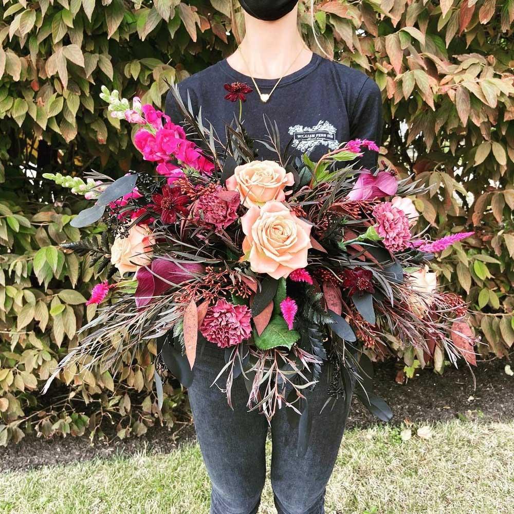 Girl standing with floral arrangement in hands